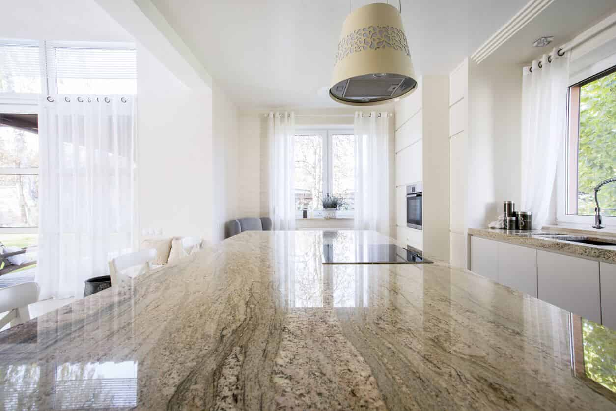 view of a clean home kitchen from marble countertop