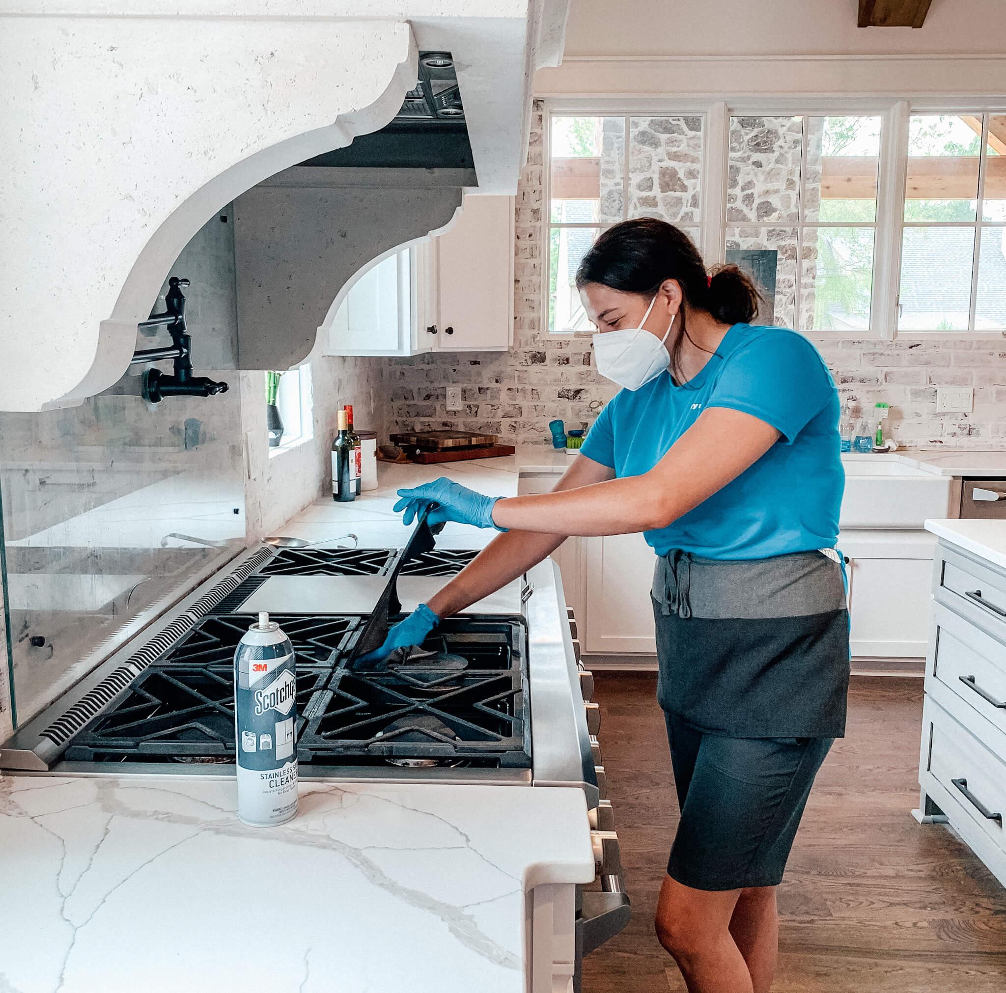 San Antonio housekeeper cleaning stovetop