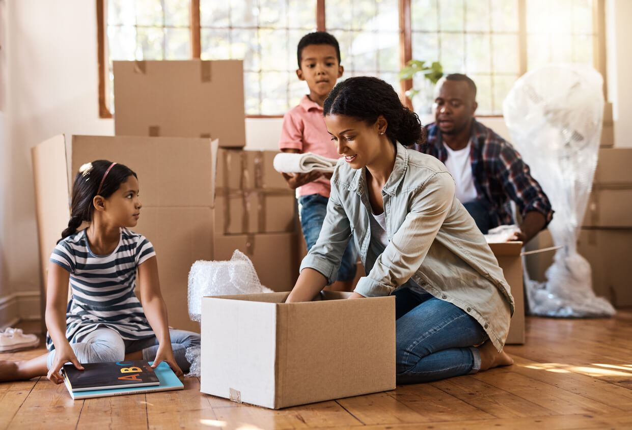 family packing boxes as they prepare to move