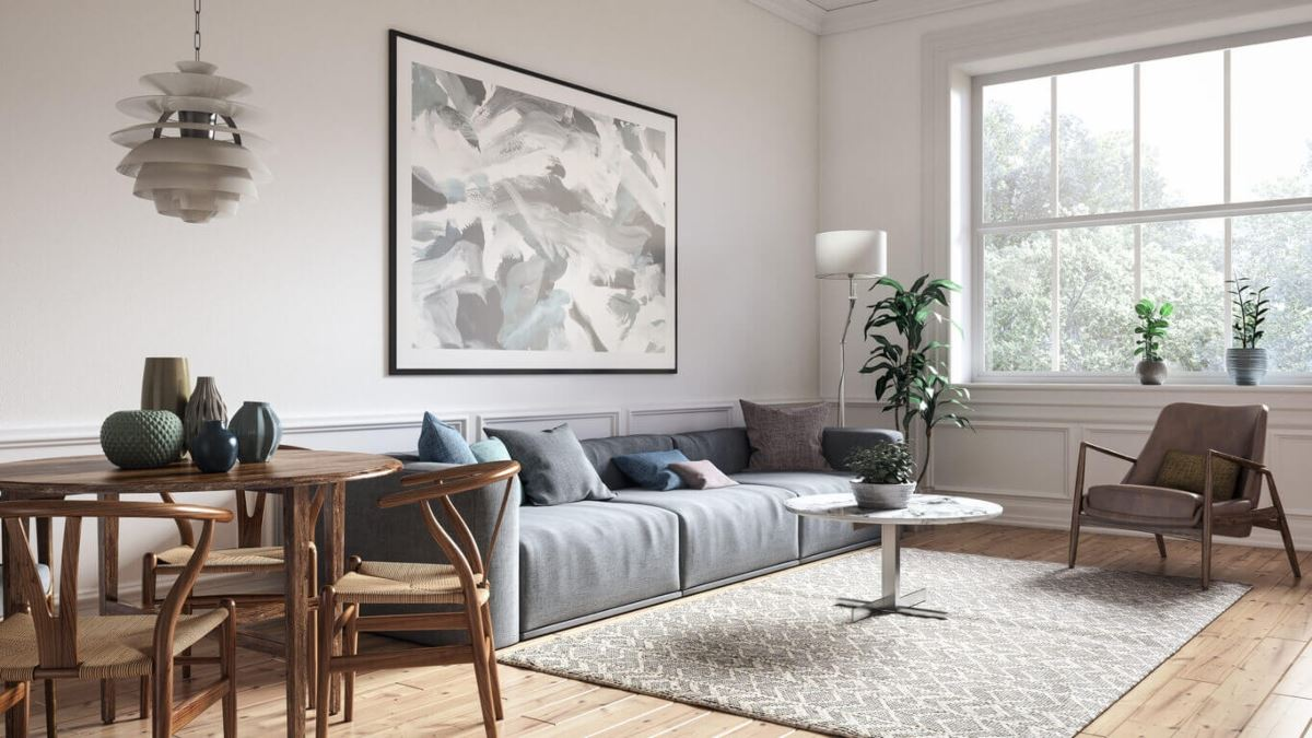 meticulously clean living room with grey couch, small dining table, and large window