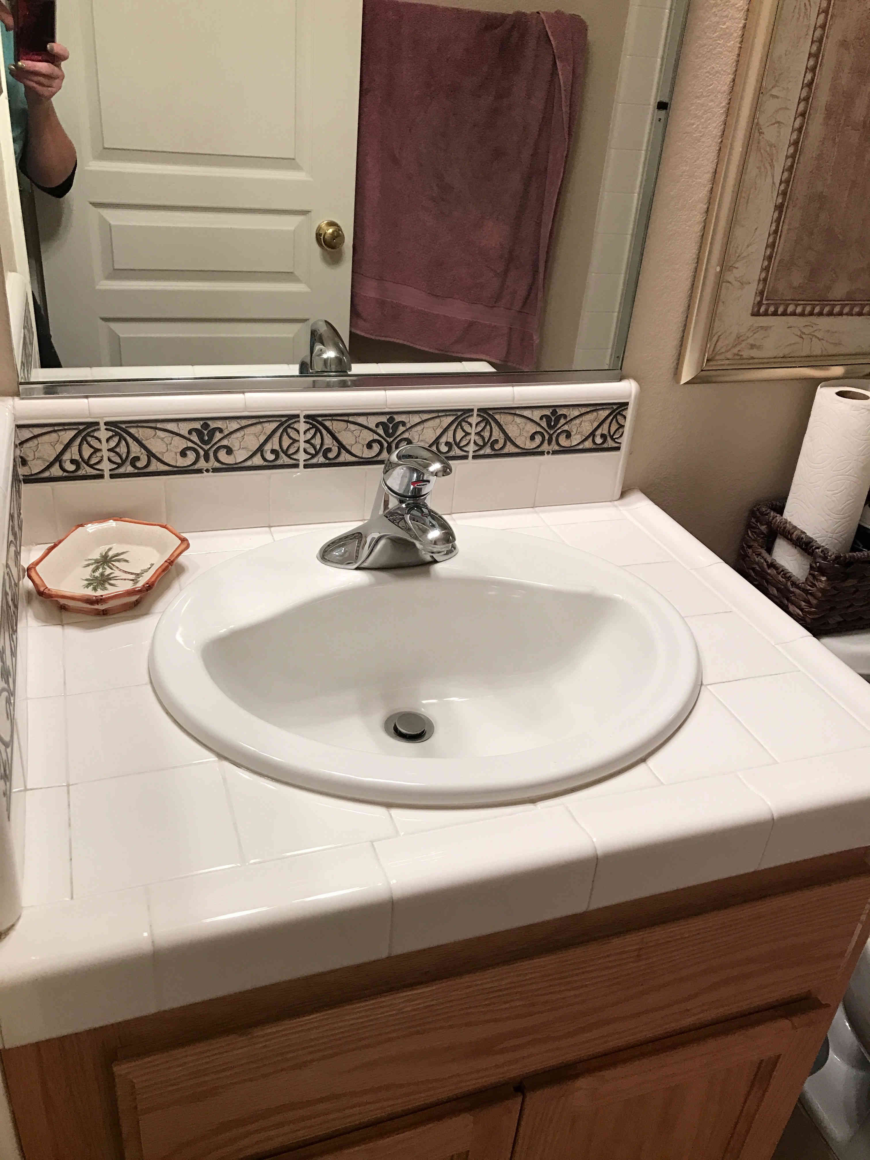 bathroom sink after being cleaned