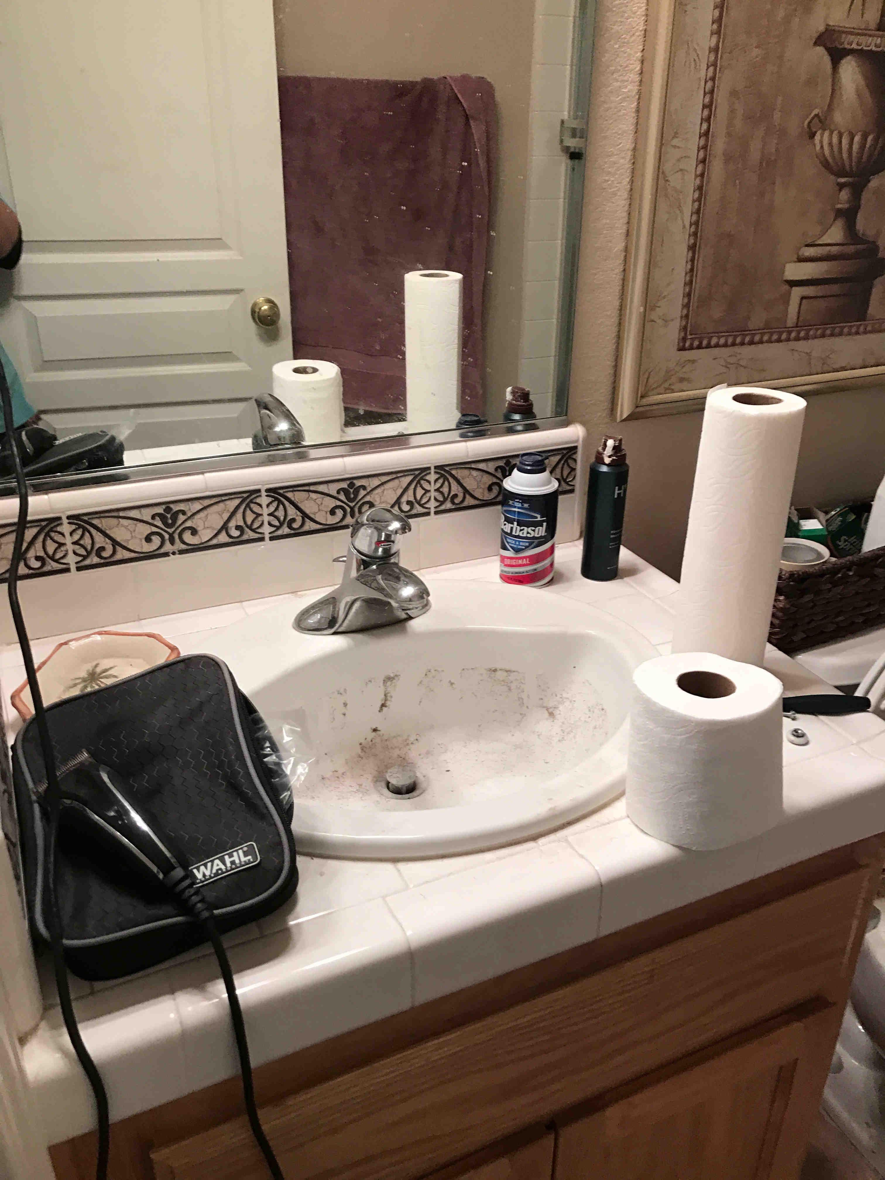 bathroom sink before being cleaned