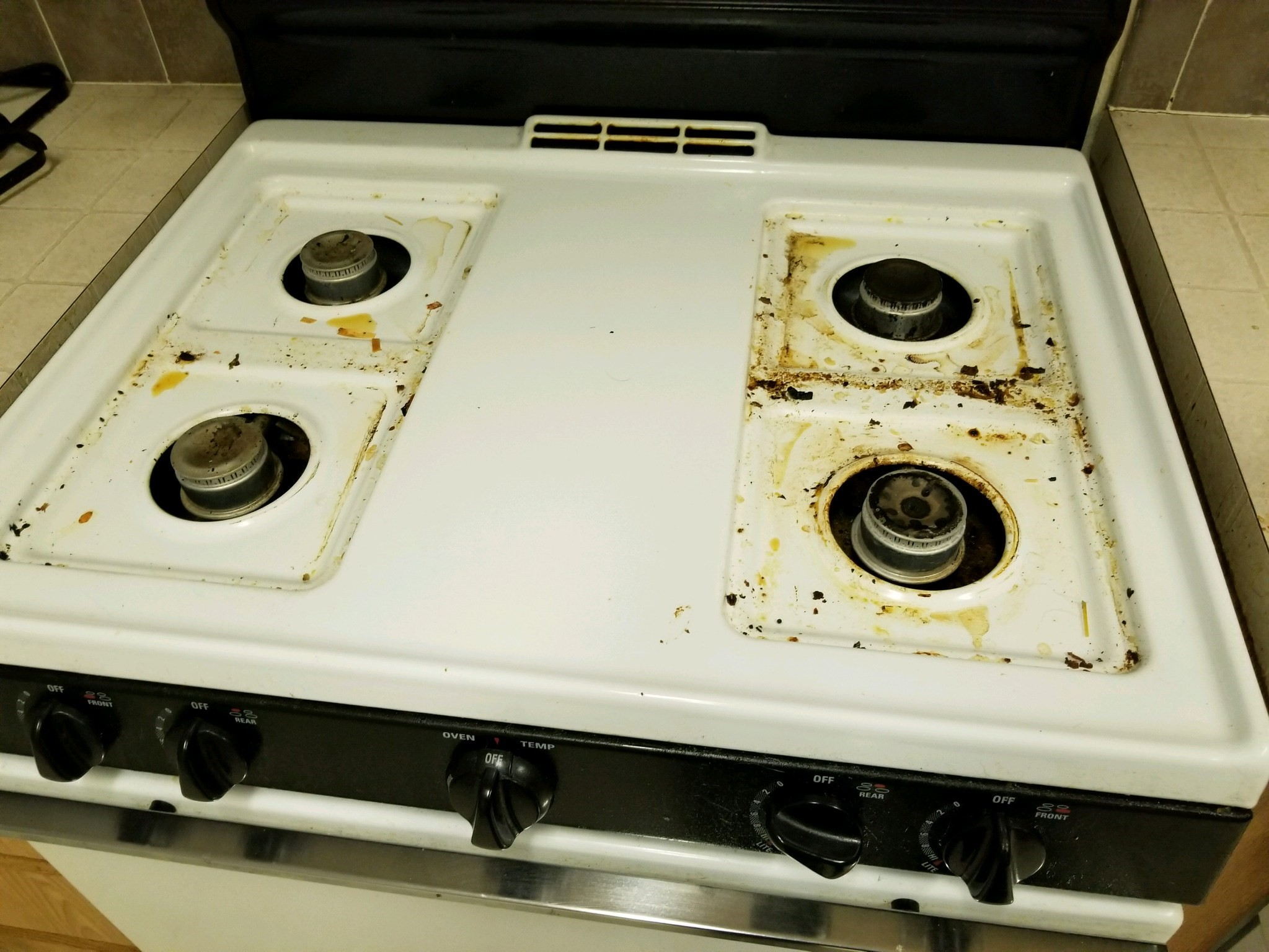 stove top before being cleaned